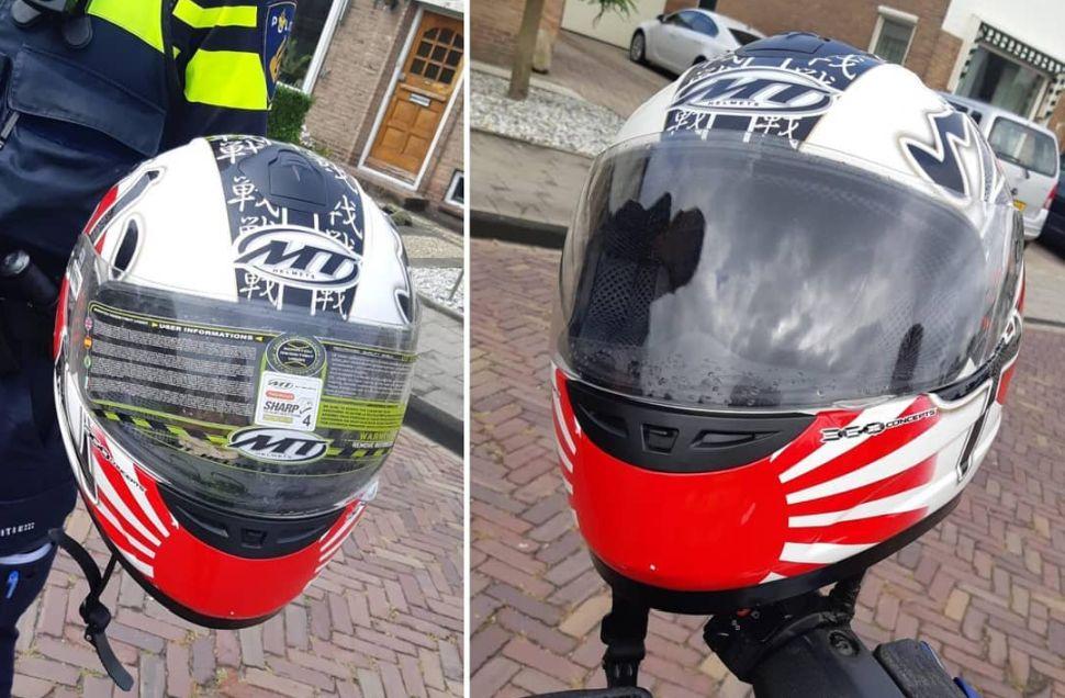 LOL: man rijdt al jaren met beschermingssticker op helm